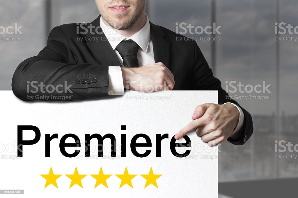businessman pointing on sign premiere stock photo