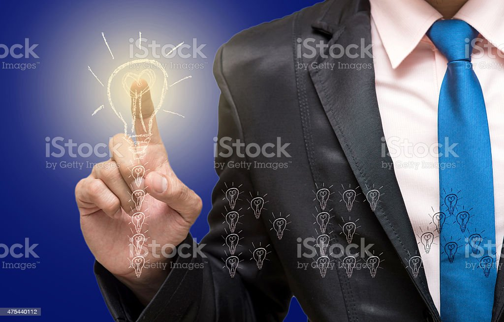 Businessman pointing or touching on the idea of success stock photo