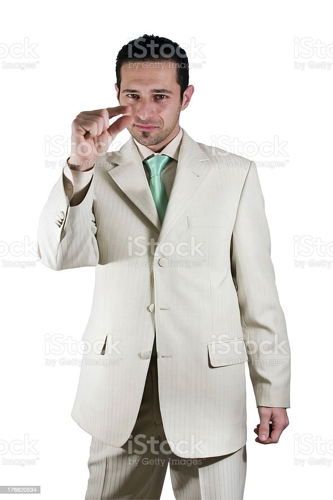 Businessman pointing out little importance stock photo