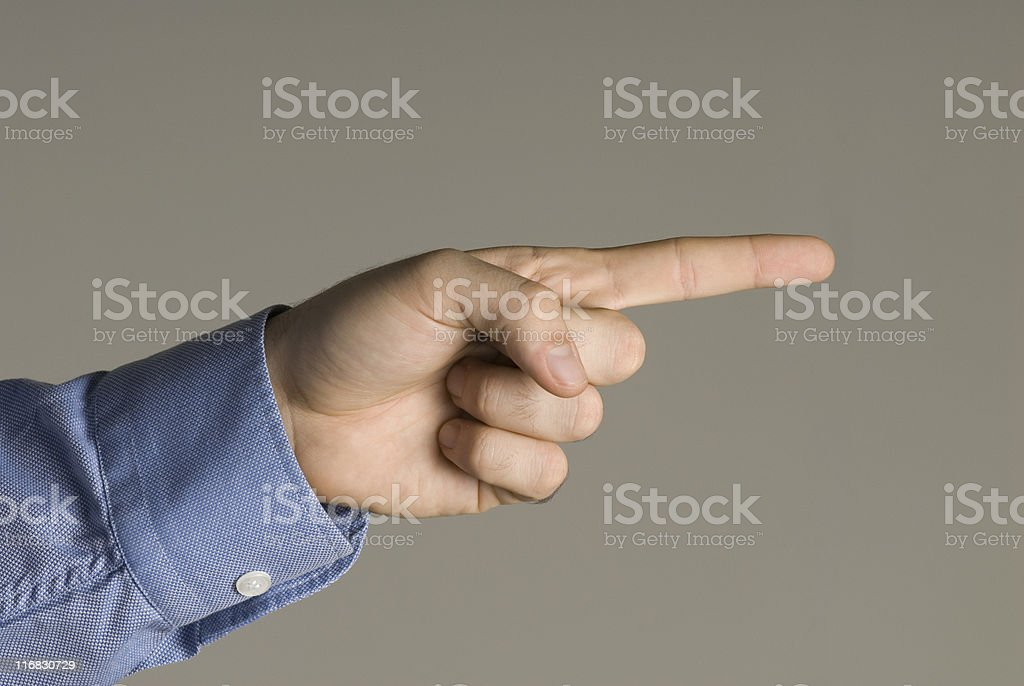 Businessman pointing (focus on hand) royalty-free stock photo
