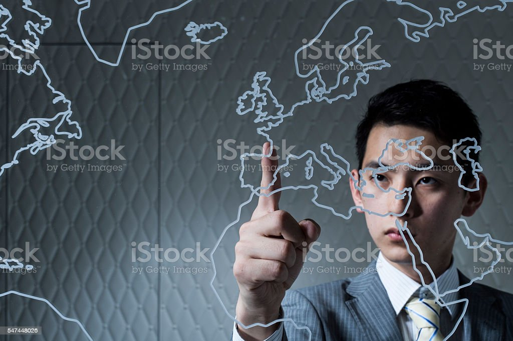 Businessman pointing the European country which will be traded stock photo