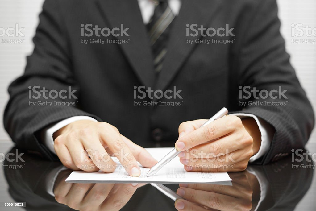 businessman pointing to mistake in report stock photo