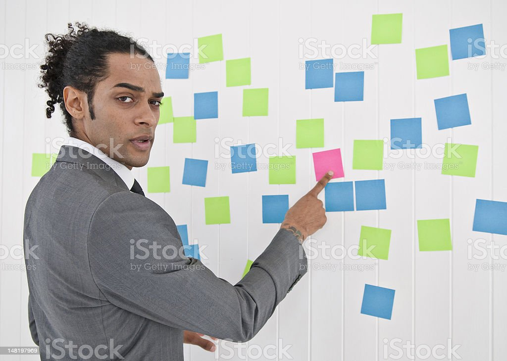 Businessman pointing to sticky note royalty-free stock photo
