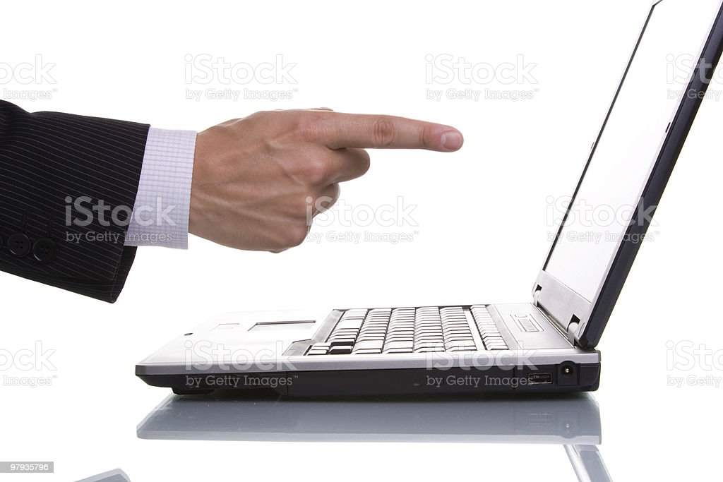 businessman pointing to the laptop stock photo