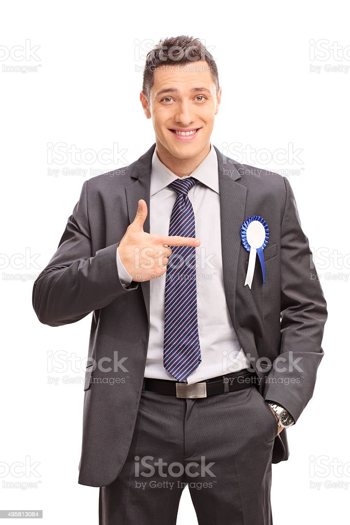 Businessman pointing towards a ribbon on his coat stock photo