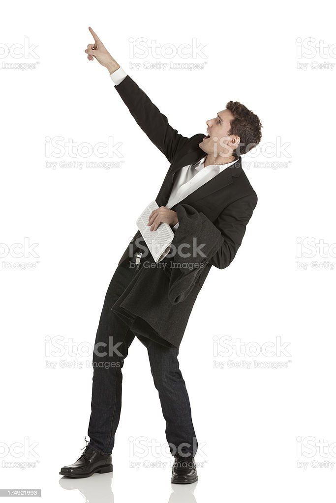Businessman pointing upward royalty-free stock photo