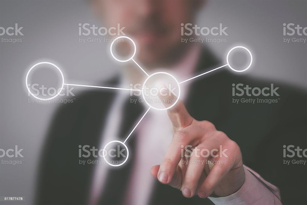 Businessman pointing  virtual user interface stock photo