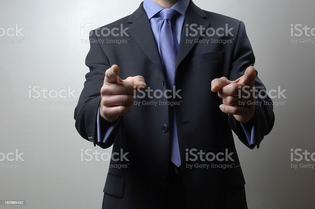 Businessman pointing with both hands stock photo