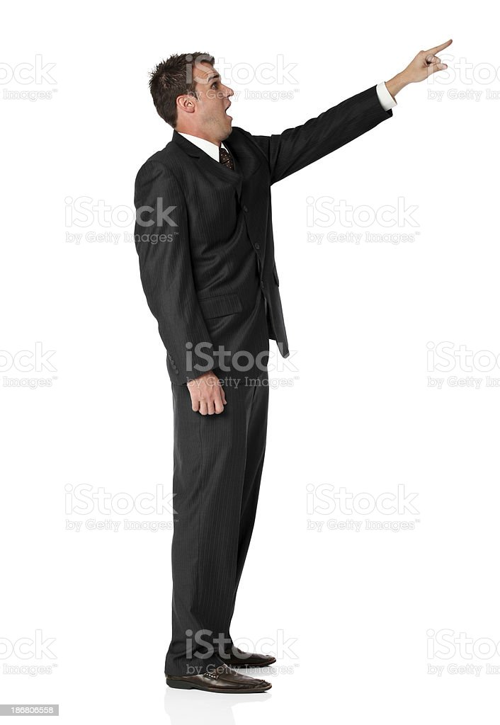 Businessman pointing with his finger and looking surprised royalty-free stock photo