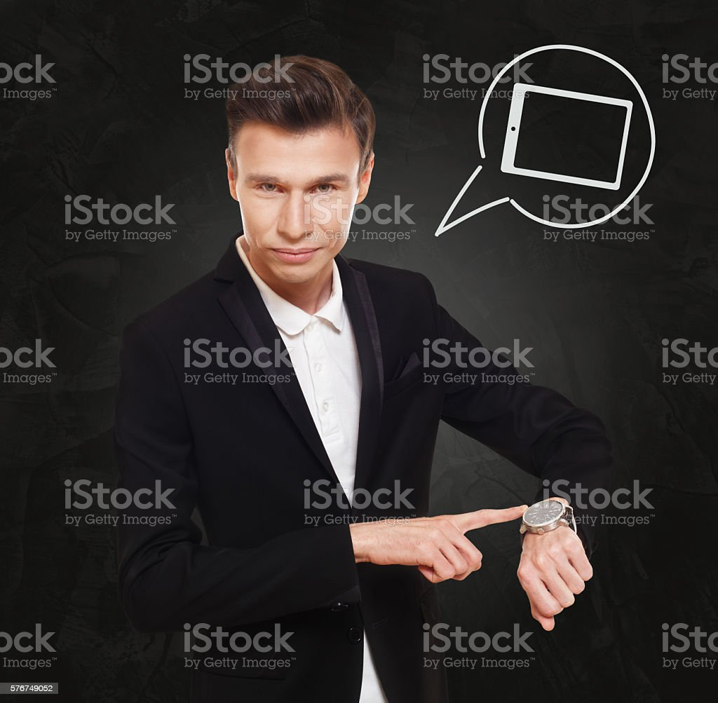 Businessman points at watch, time to call stock photo