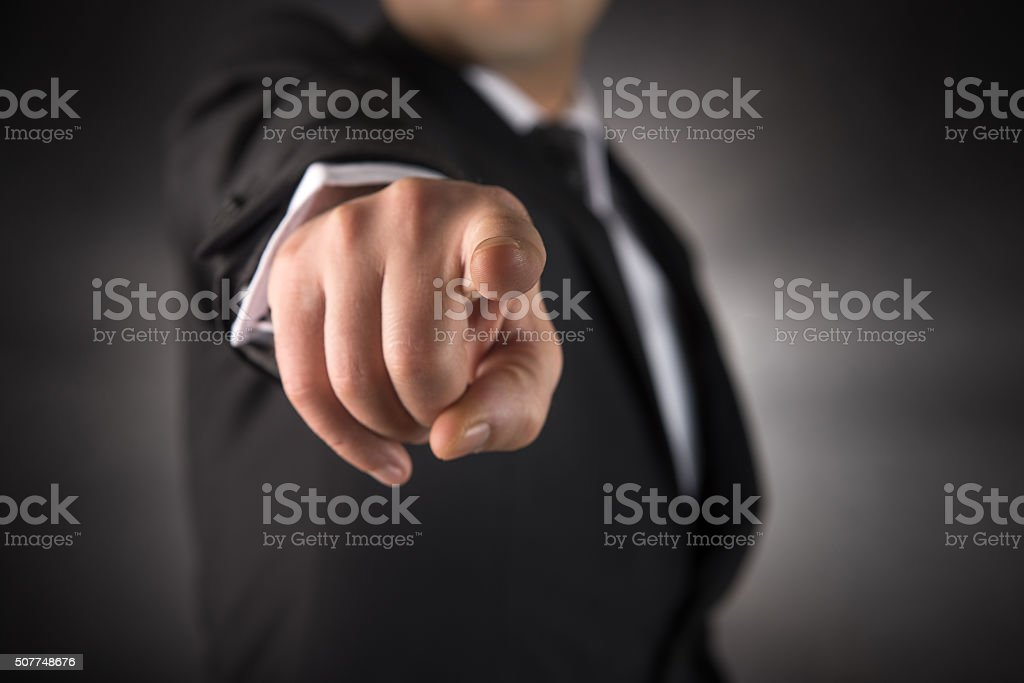 Businessman points his finger at you stock photo