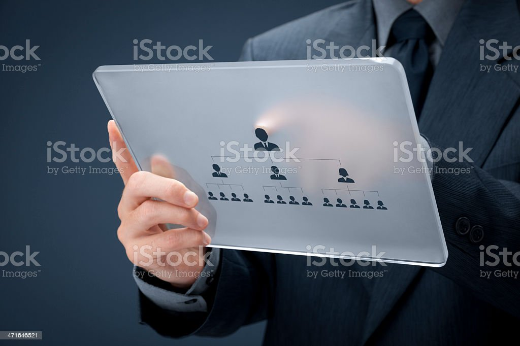 Businessman points to the CEO on a lucite tablet stock photo