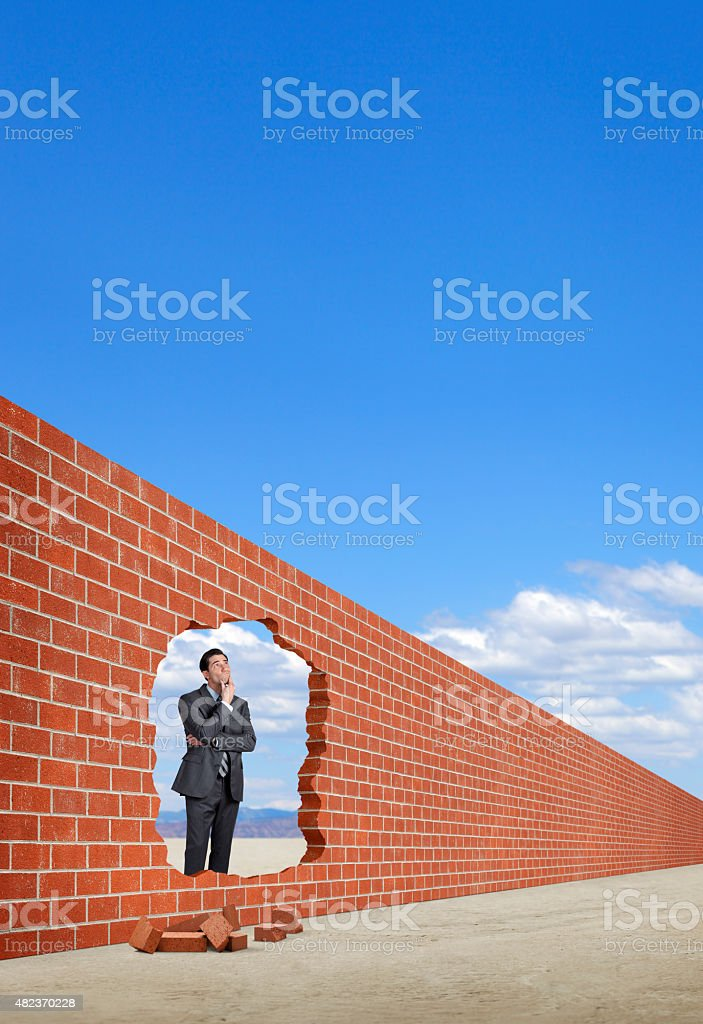 Businessman Pondering A Breakthrough stock photo