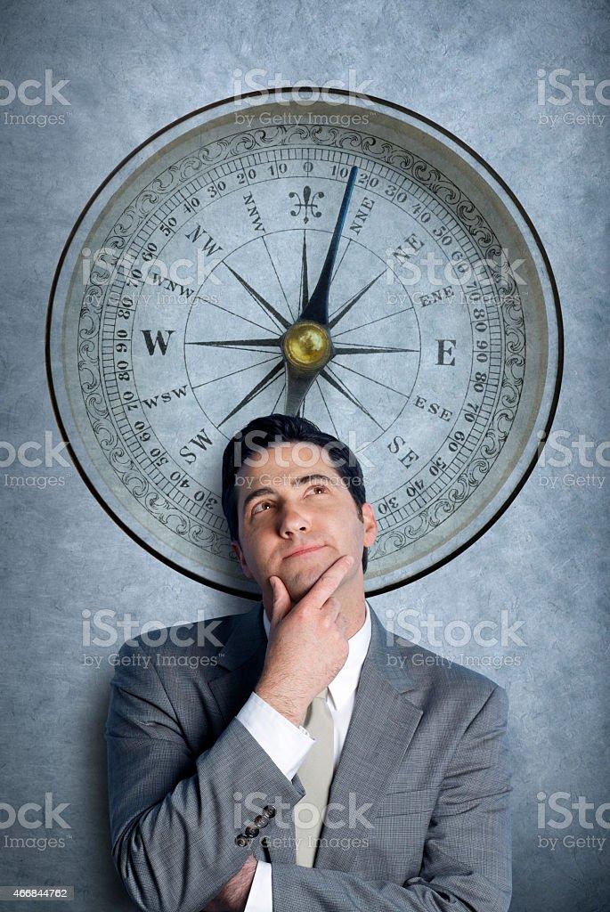 Businessman pondering decisions stock photo
