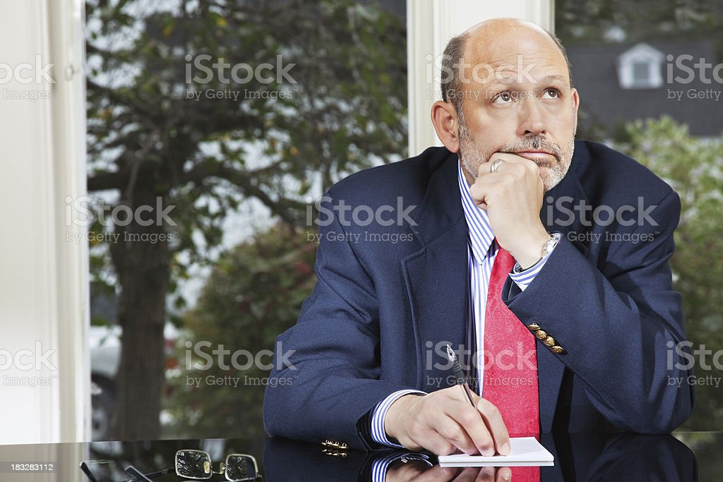Businessman Pondering in His Office royalty-free stock photo
