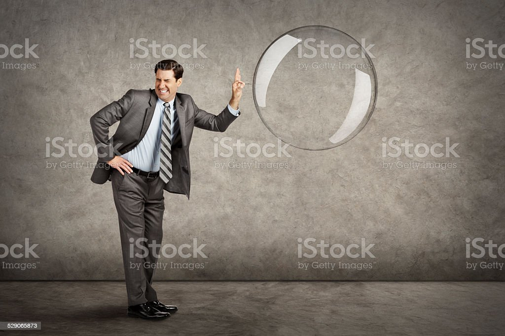 Businessman Popping A Bubble stock photo