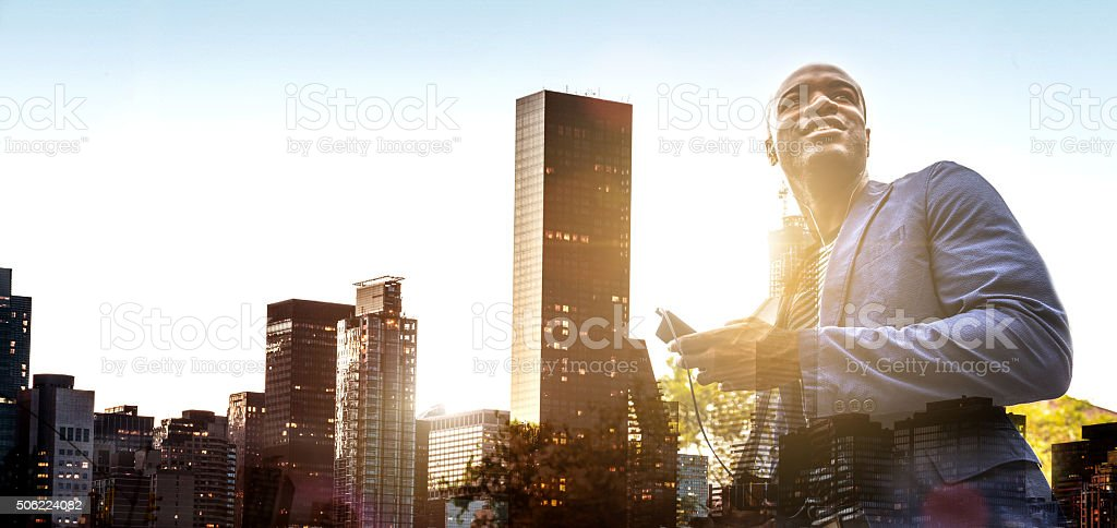Businessman portrait in front skyline stock photo