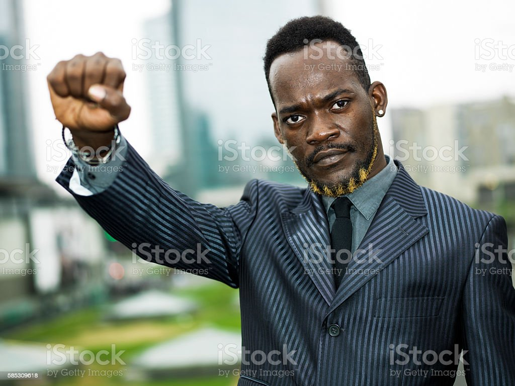Businessman portrait in the city with raised fist stock photo