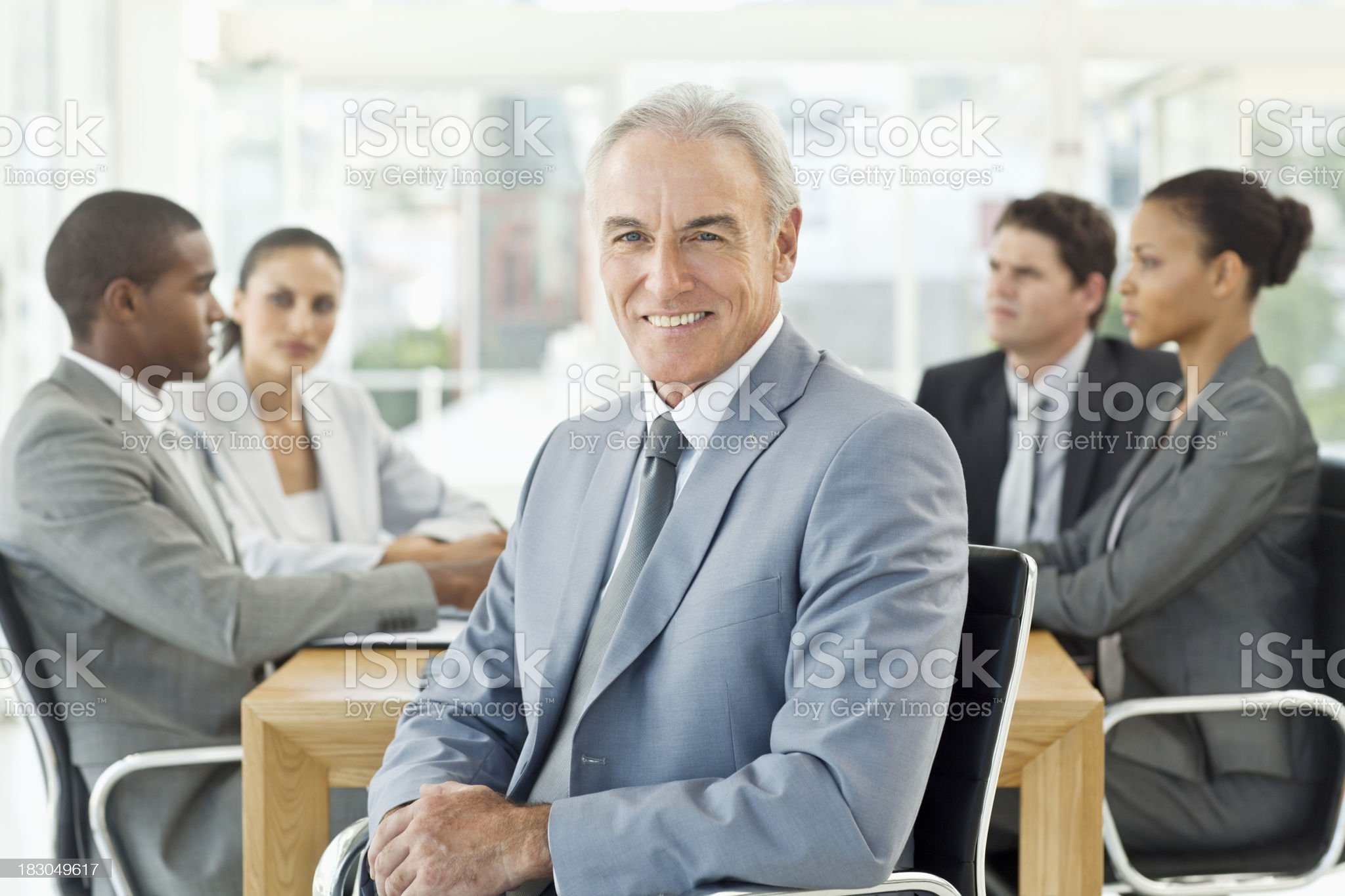Businessman Posing at a Boardroom Meeting royalty-free stock photo