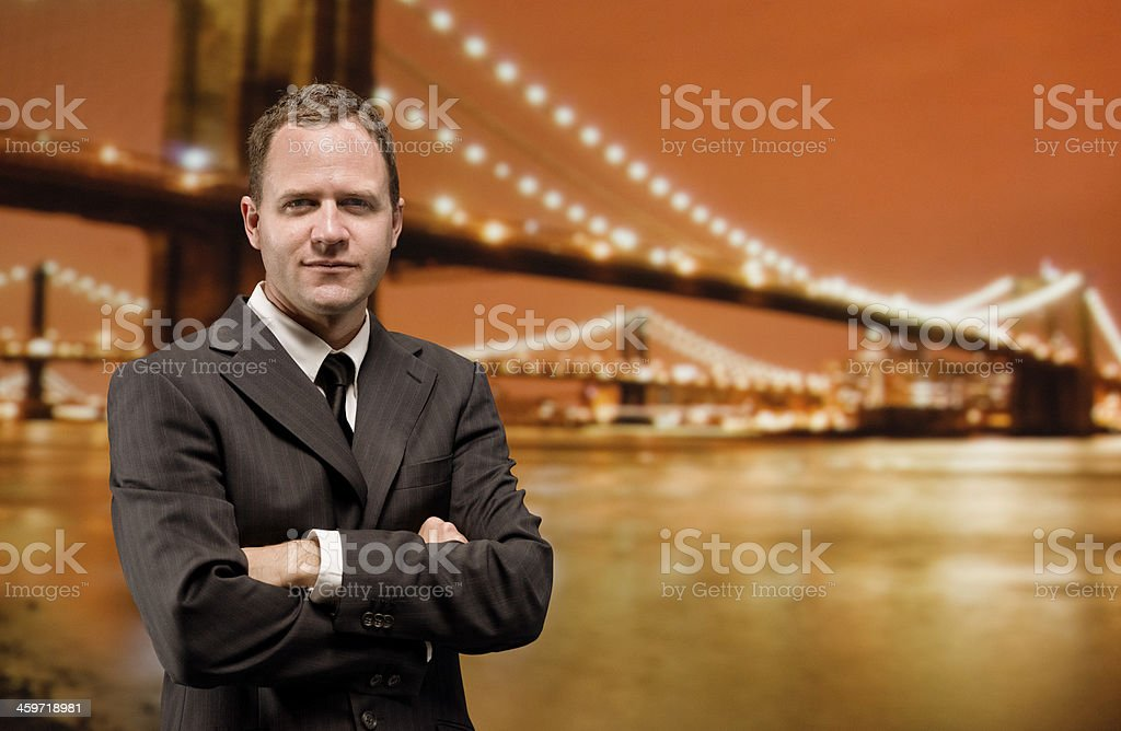 Businessman posing in front of Brooklyn bridge royalty-free stock photo