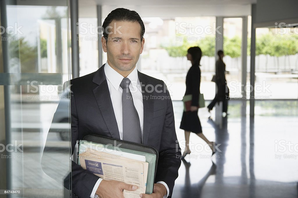Businessman posing in office lobby royalty-free stock photo