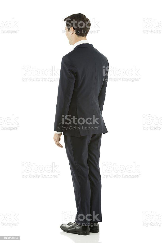 Businessman posing rearview royalty-free stock photo