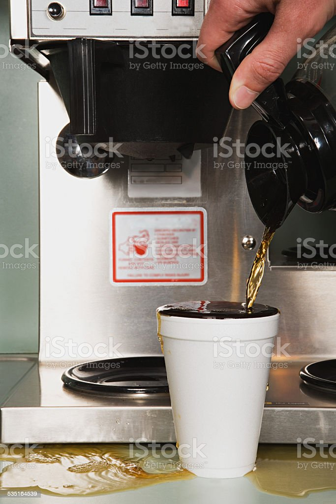 Businessman pouring a coffee stock photo