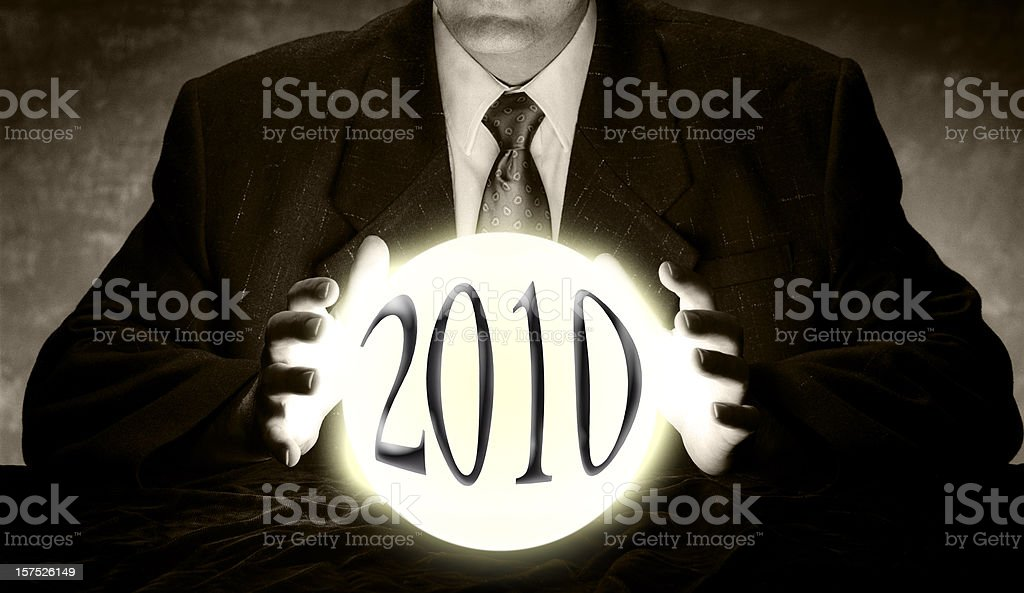 Businessman Predicting 2010 with Crystal Ball stock photo