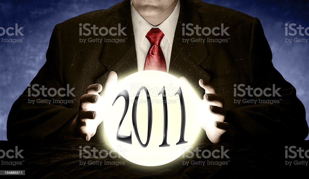Businessman Predicting 2011 with Crystal Ball stock photo