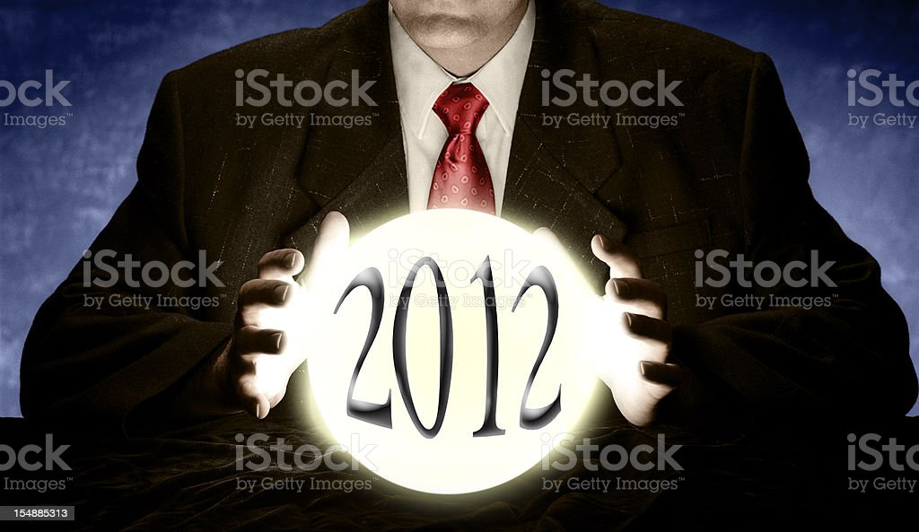 Businessman Predicting 2012 with Crystal Ball stock photo