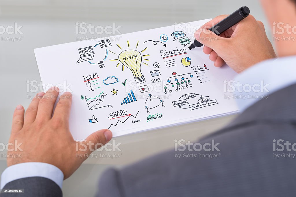 Businessman Preparing Startup Plan On Paper stock photo