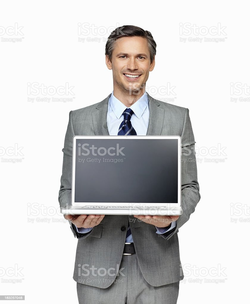 Businessman presenting a laptop against white background royalty-free stock photo