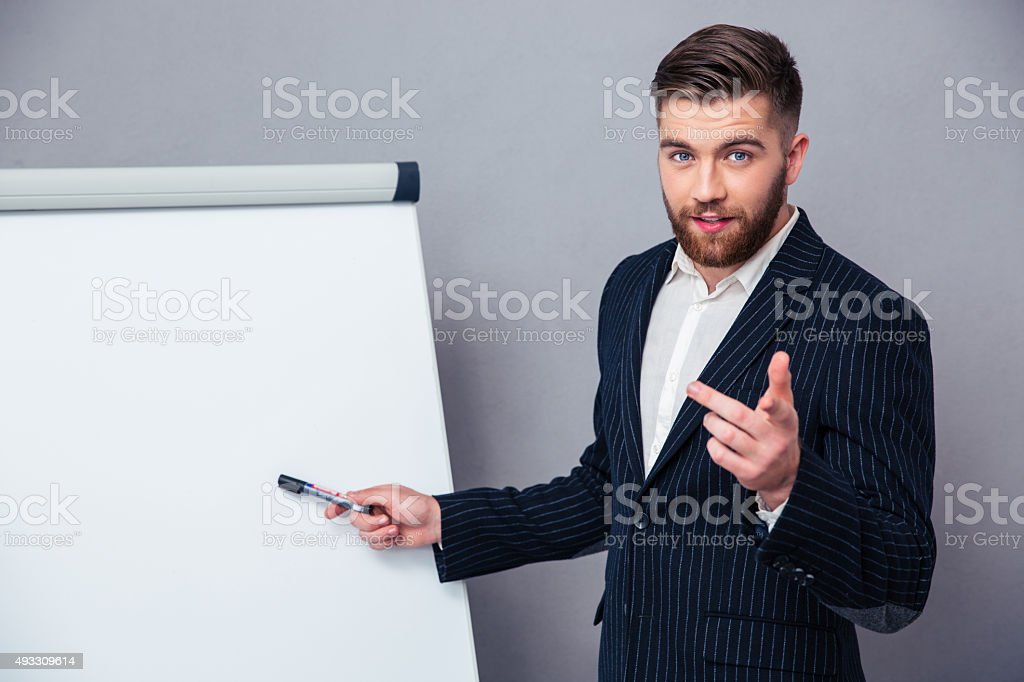 Businessman presenting something on blank board stock photo