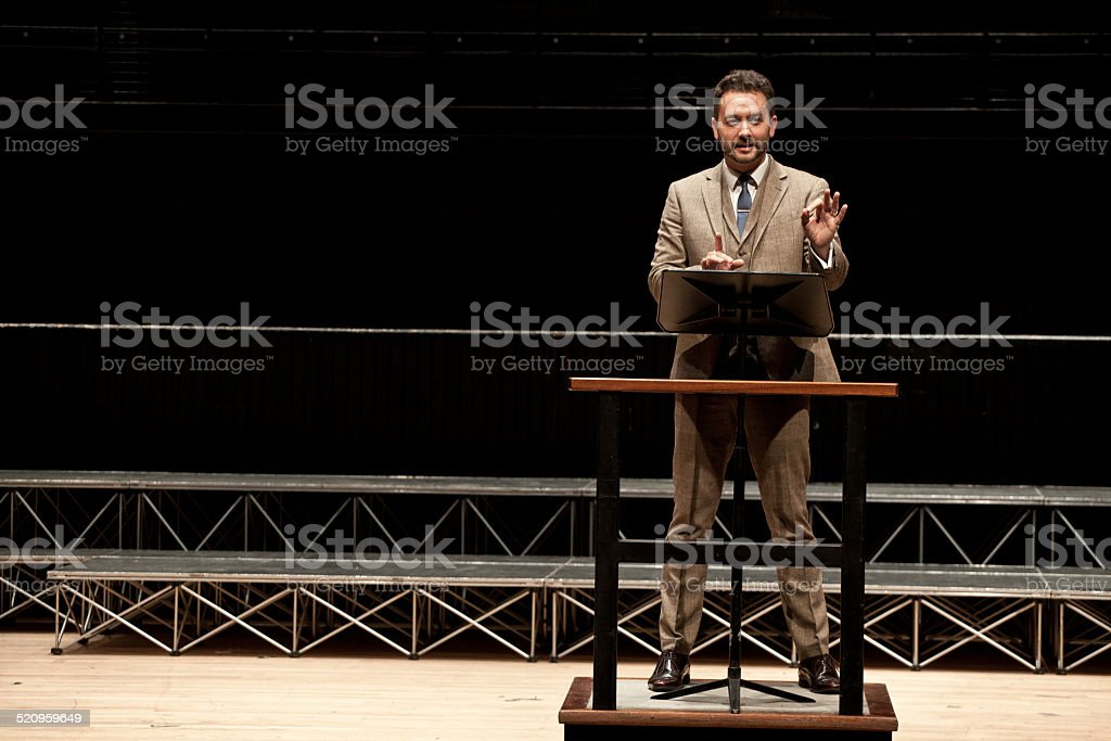 Businessman Presenting to an Audience stock photo