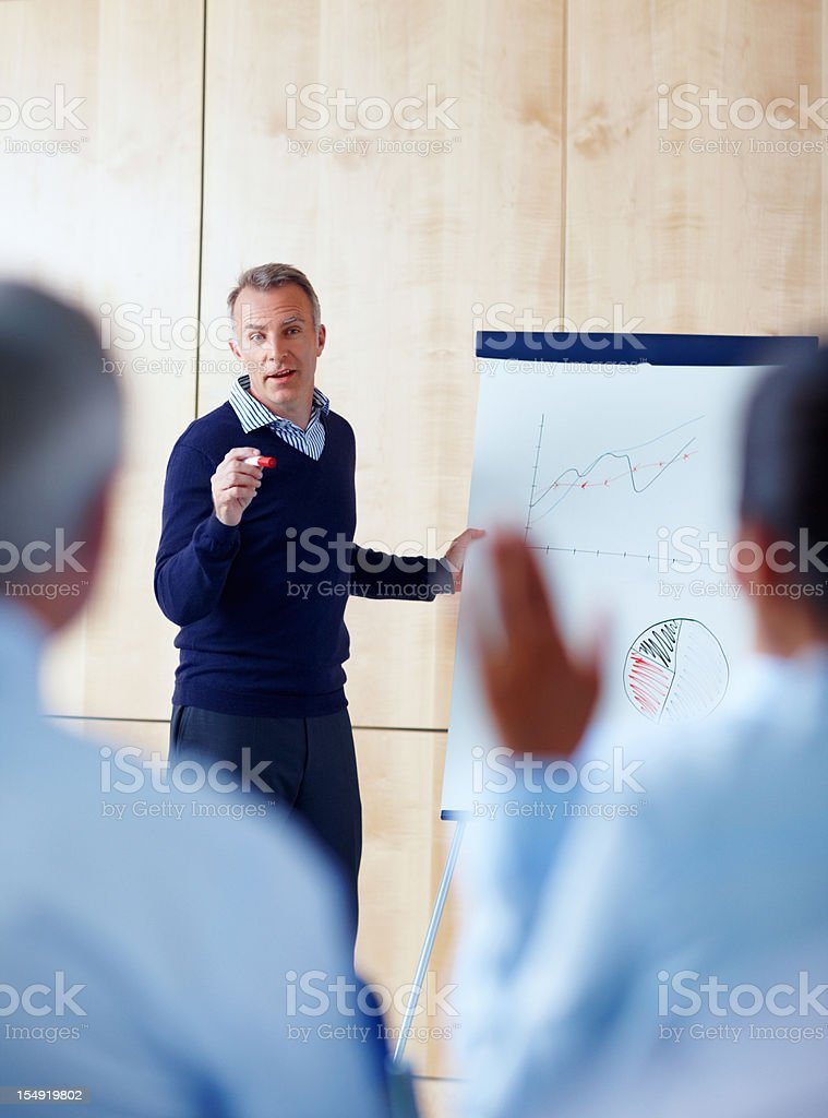 Businessman presenting to group royalty-free stock photo