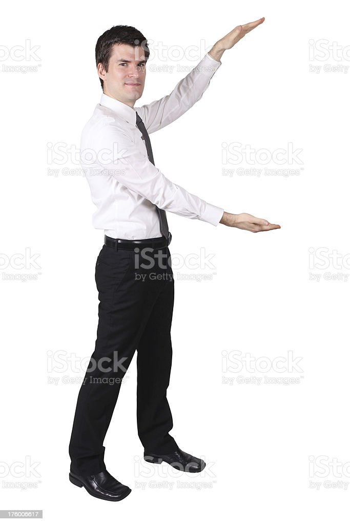 Businessman presenting with arms to left royalty-free stock photo
