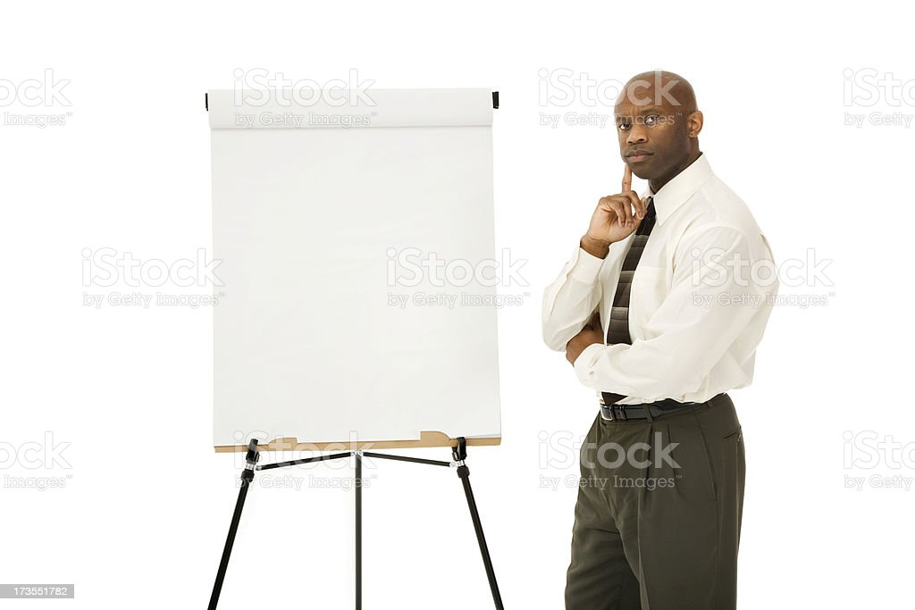 Businessman Presenting with Easel royalty-free stock photo