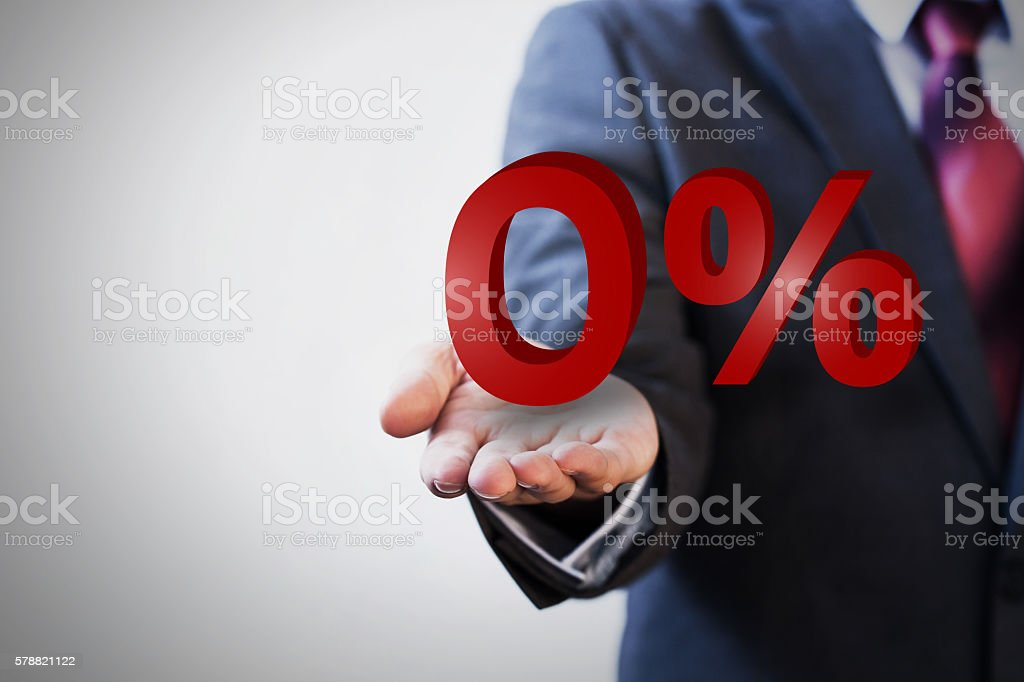 Businessman presenting zero percent graphic stock photo