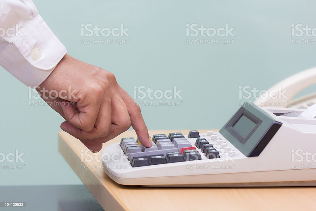 businessman press button calculater royalty-free stock photo