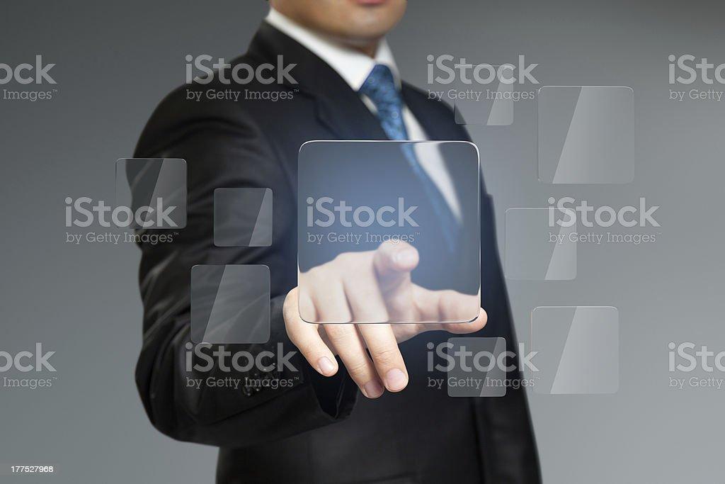Businessman press button with copyspace. Future technology. stock photo
