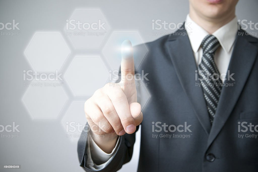 Businessman presses a button on the touch screen stock photo