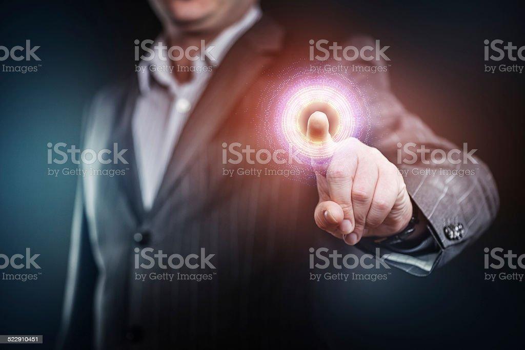 Businessman pressing a futuristic button stock photo