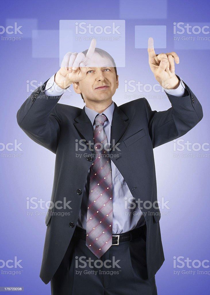 Businessman pressing a touchscreen button royalty-free stock photo