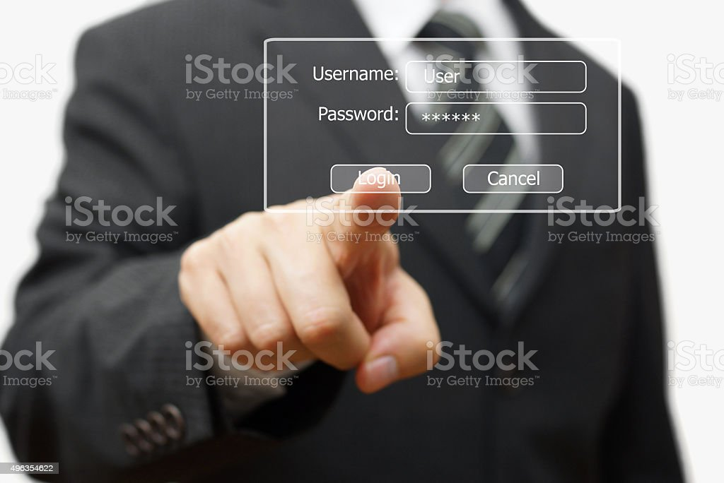 businessman pressing authentication button on login display stock photo