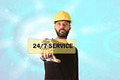 Businessman pressing button 24 hours service icon over
