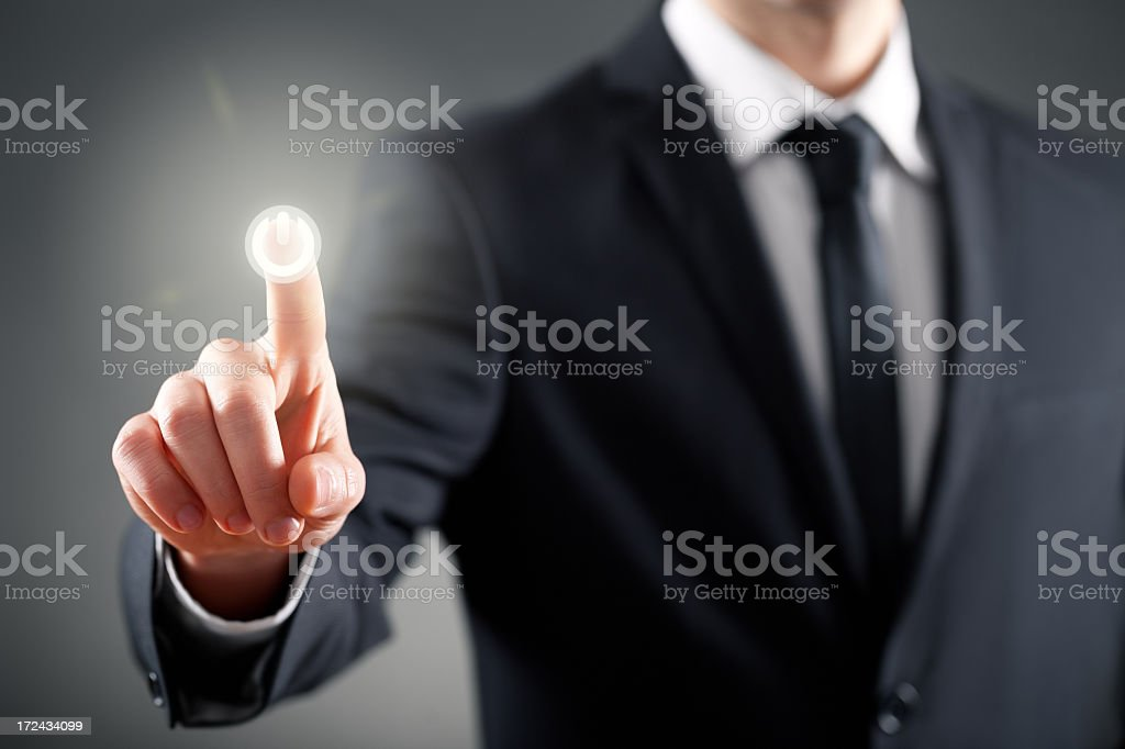 Businessman pressing button on touch screen stock photo