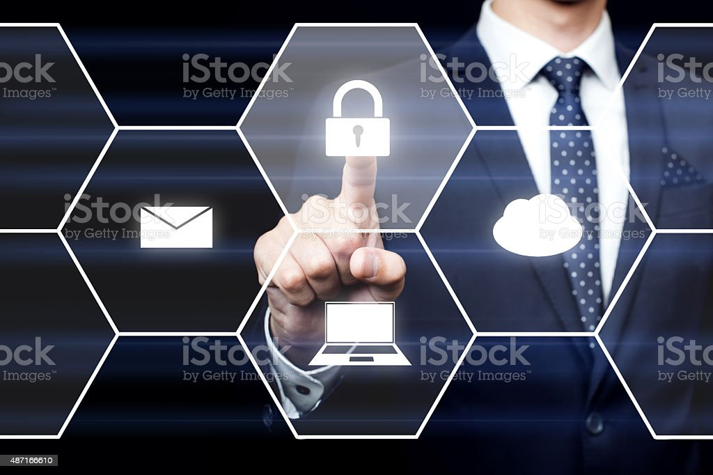 businessman pressing button on virtual screens stock photo