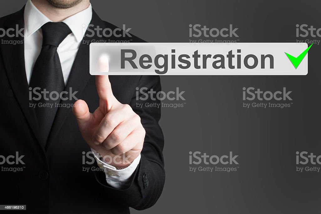 businessman pressing button registration stock photo