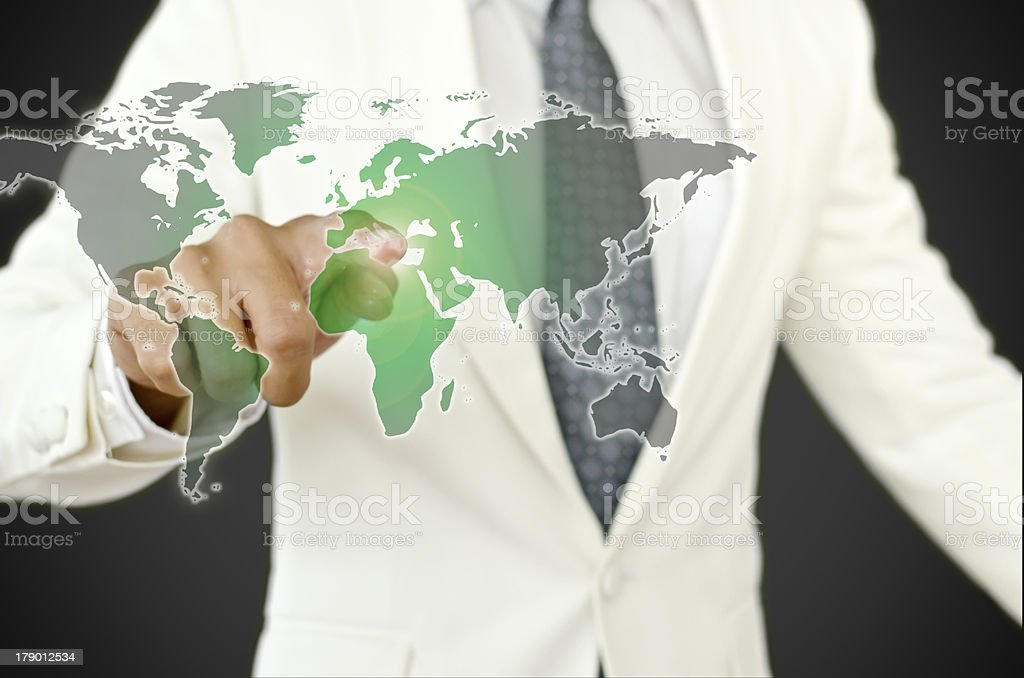 Businessman pressing , change black world to green earth royalty-free stock photo