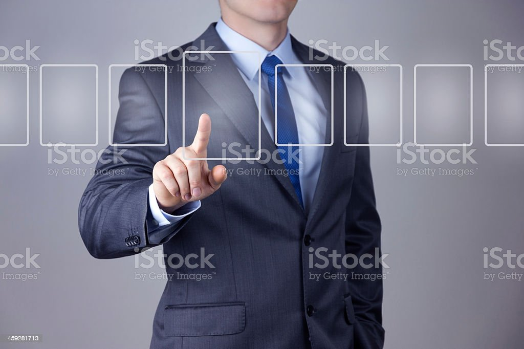 Businessman pressing digit rectangle from a row stock photo
